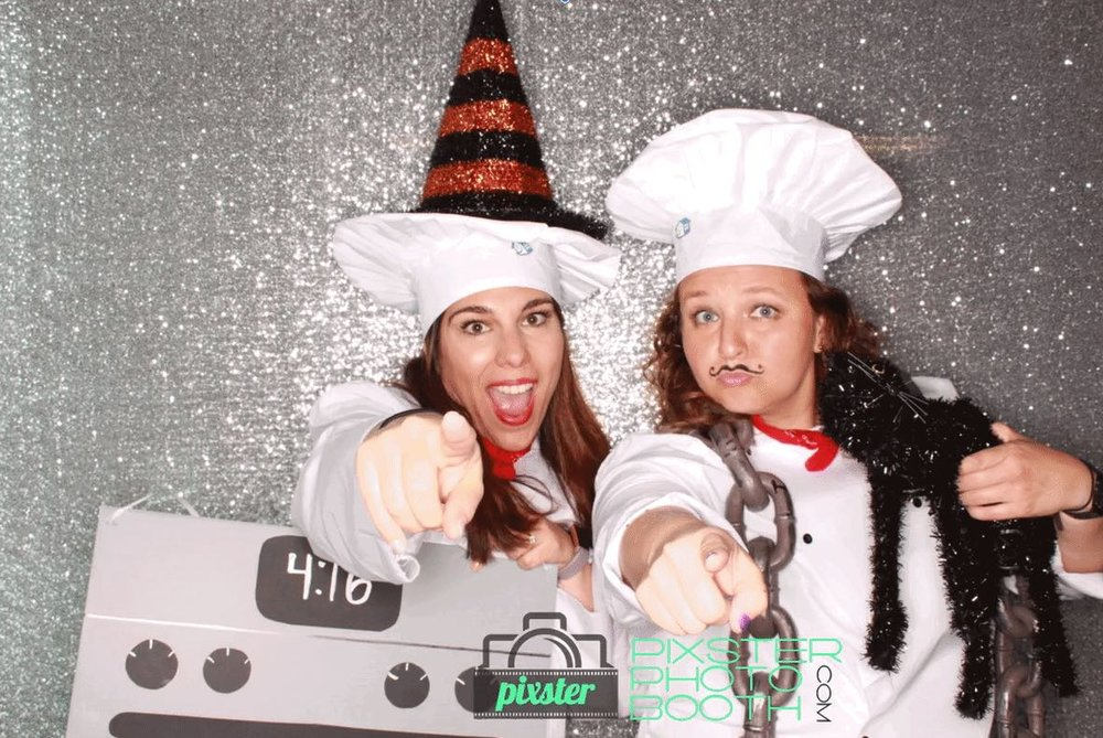 Meredith and her manager, Jaime M. posing in the photo booth for Halloween.