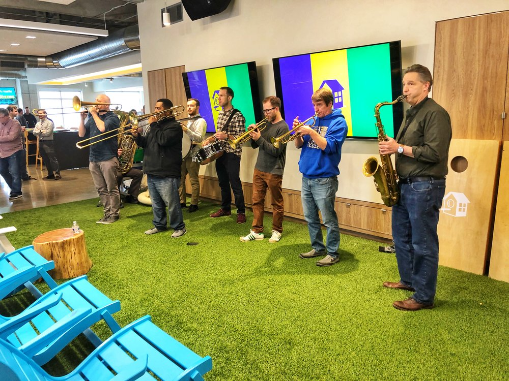 The Urban Achievers Brass Band celebrating Mardi Gras with Team HomeAway in our Austin office.