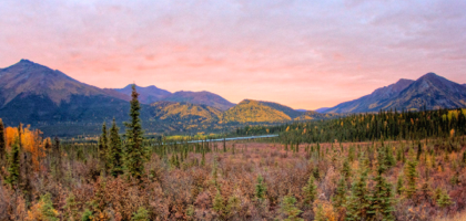 HDR rendering of the Alaskan wilderness with the famous Alaskan pipeline running across the photo.