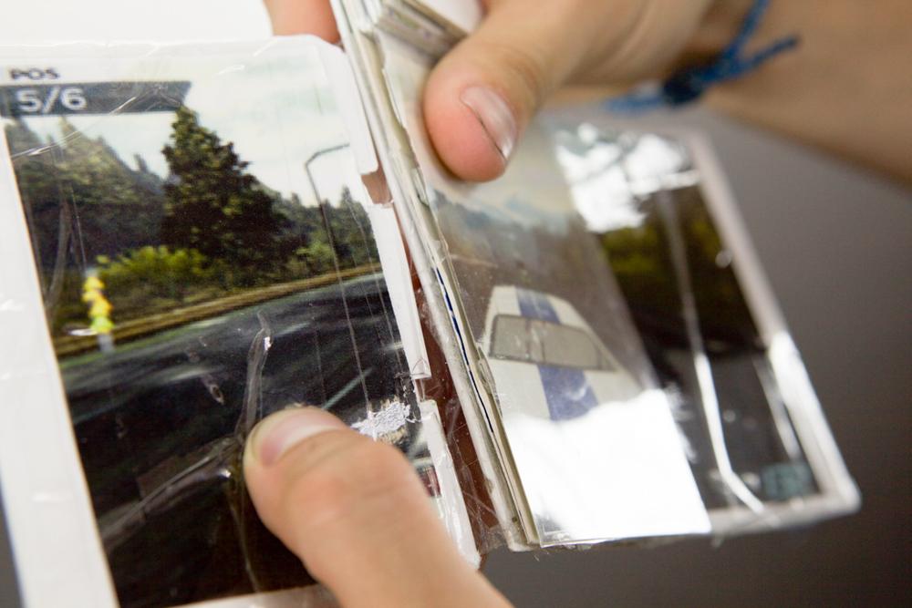 A hinge mechanism clicks side panelsbehind center screen enabling edge to edge display.