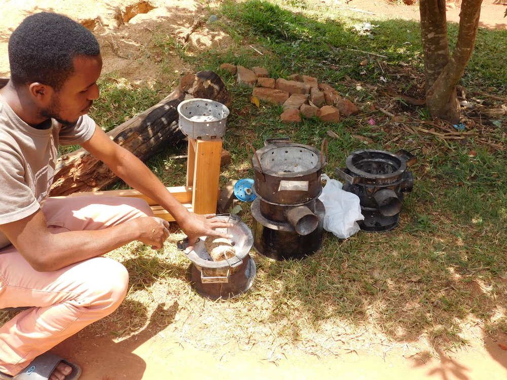 Sungani demonstrates basic briquette production in three versions of cookstoves, including Green Heat Malawi's improved stove that optimizes cooking potential when used with their briquettes.