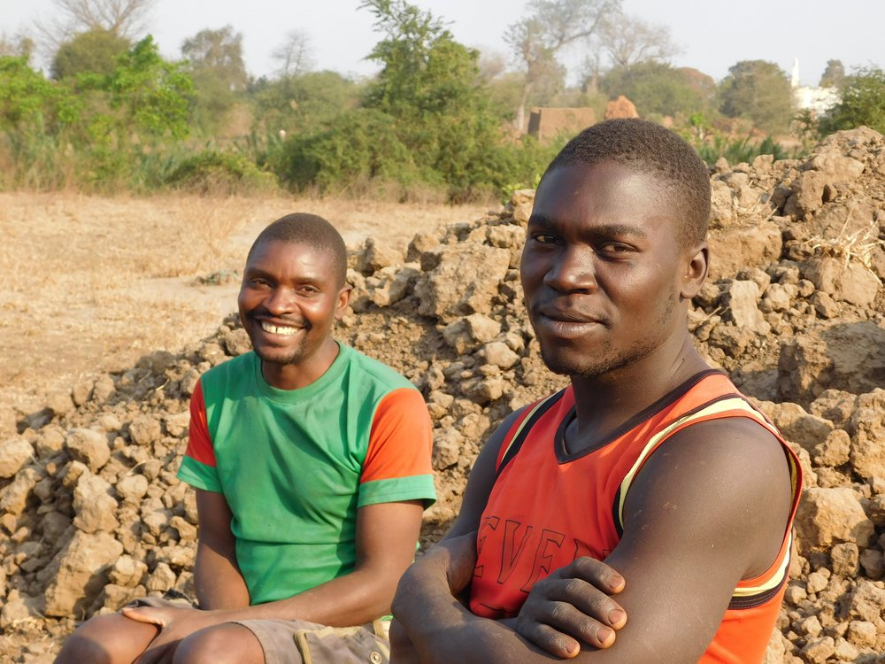 On-site at Tione Kaonga's first aquaculture pond in southern Malawi. These two men dug the aquaculture pond by hand. Tione participated in Flame Tree Initiative's Development Entrepreneurship Lab in 2015 and now successfully operates multiple ponds.
