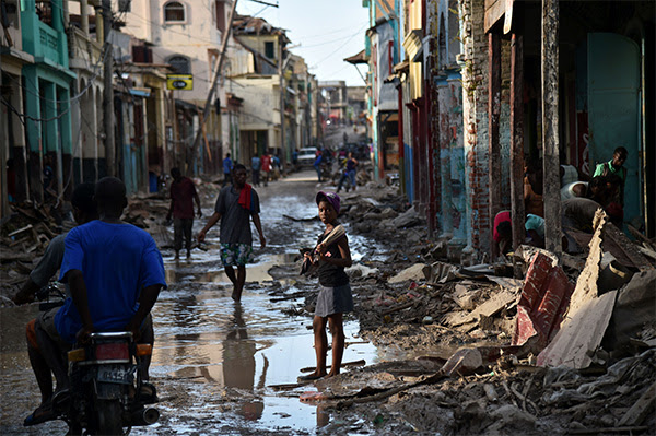 Hector Retamal/AFP/Getty Images A girl walks on a street damaged in Hurricane Matthew, in Jeremie, in western Haiti, on October 7. The full scale of the devastation in the hurricane-hit country became clear as the death toll surged over 400 three days after Hurricane Matthew leveled huge swaths of the country's south.