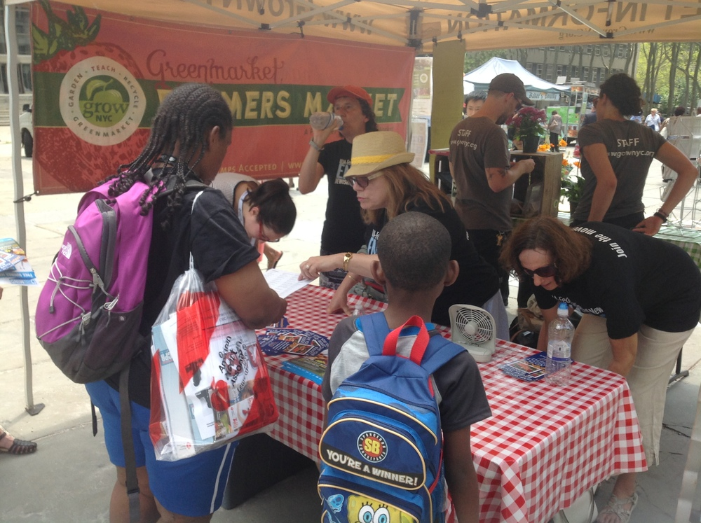 Engage volunteers Sharon  Sonnenschein, Robyn Gottlieb and Nancy Glaser conducting SNAP outreach at a Farmers' Market.