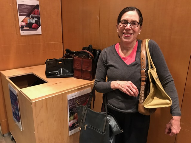 Amy Epstein with the donated handbags