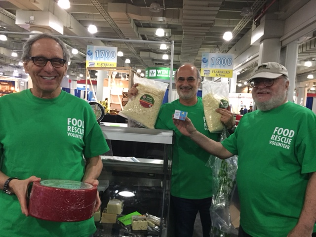 Fred Reichman, Sam Bliman, and Bob Grossweiner (left to right) volunteering with City Harvest