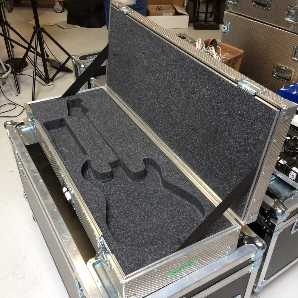 "Guitar Flight Case 1  Make: Engineered Case Manufacturers  Dimensions: 43"" X 16"" X 6.5""  Notes: Stratocaster Foam Cutout"