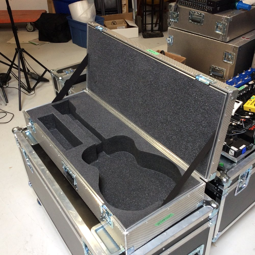 "Acoustic Guitar Flight Case  Make: Engineered Case Manufacturers  Dimensions: 43"" X 17"" X 7.5""  Notes: Martin Foam Cutout"