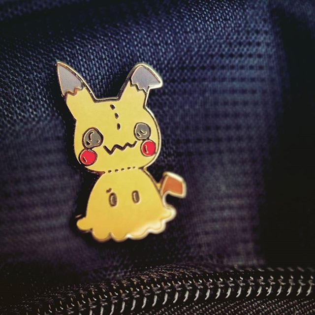 My coworker who I have enjoyed working with is leaving on Friday for a new job.  But she got me an amazing pin before she left.  Thanks @pantherchild for the #mimikyu pin!!