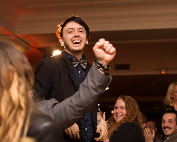 Christian (standing), hears that he won BOS at the ADDY event.  (Photo by Brogen Jessup)