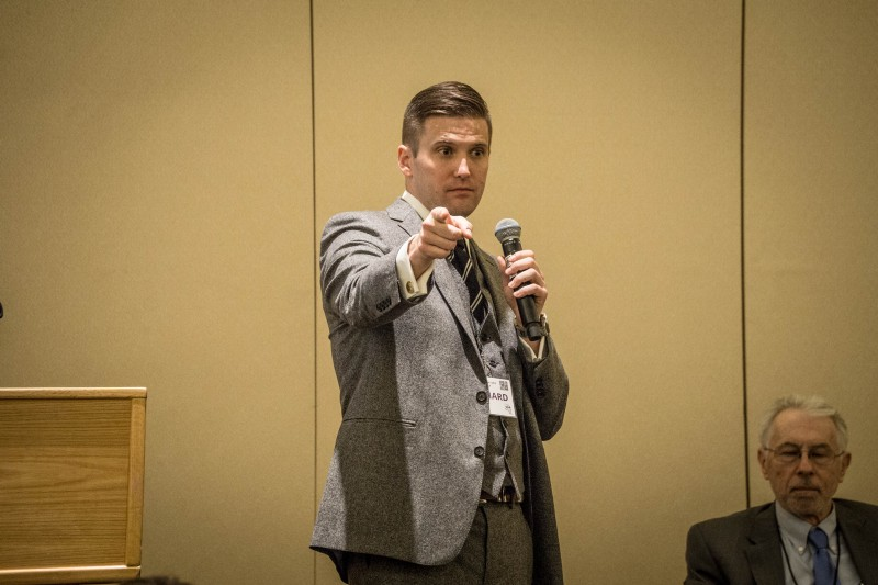 "Richard Spencer takes the stage at ""Become Who We Are,"" a conference arranged by his National Policy Institute, Washington DC, November 19, 2016. Image:  V@s , Flickr"