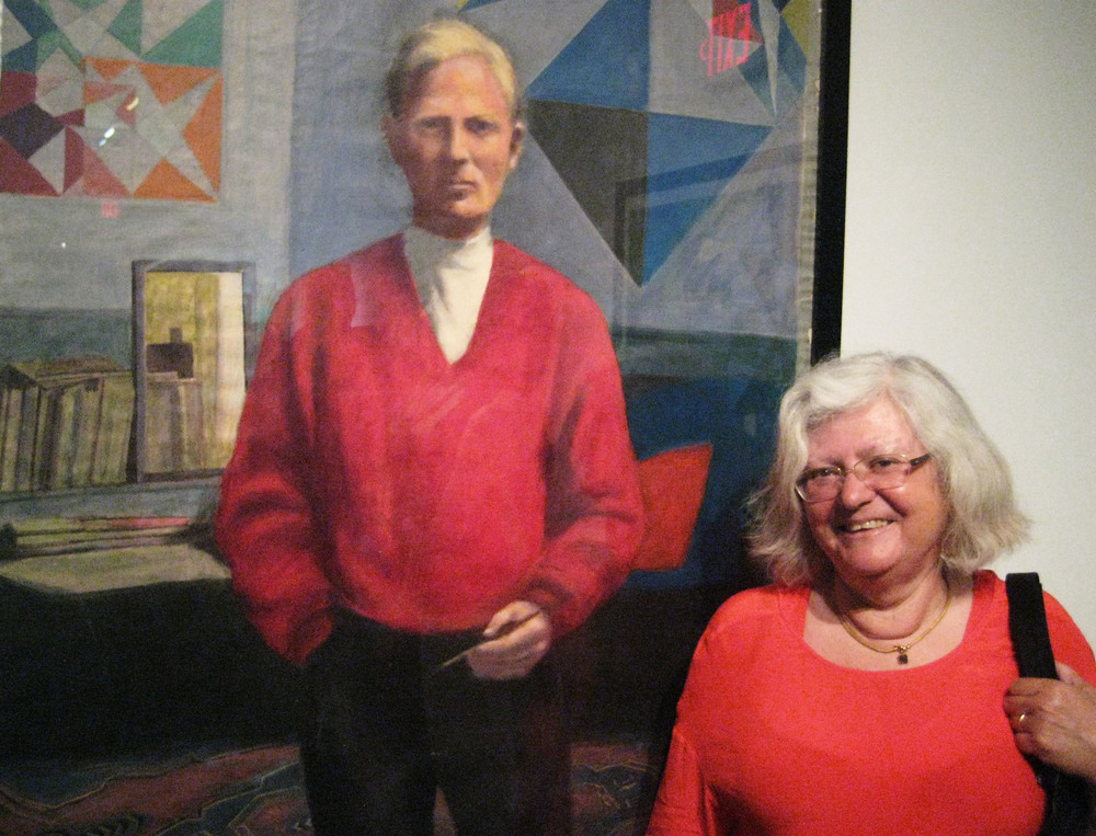 Eva Sverdrup-Jensen in front of a self-portrait of Benny