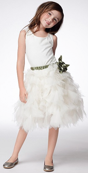 """Dress 42370"" is an off white cotton knit, sleeveless dress with a separate ivory dramatic, tulle appliquéd skirt with satin ribbons covered elastic waistband/flower. This ruffled skirt is to die for!"