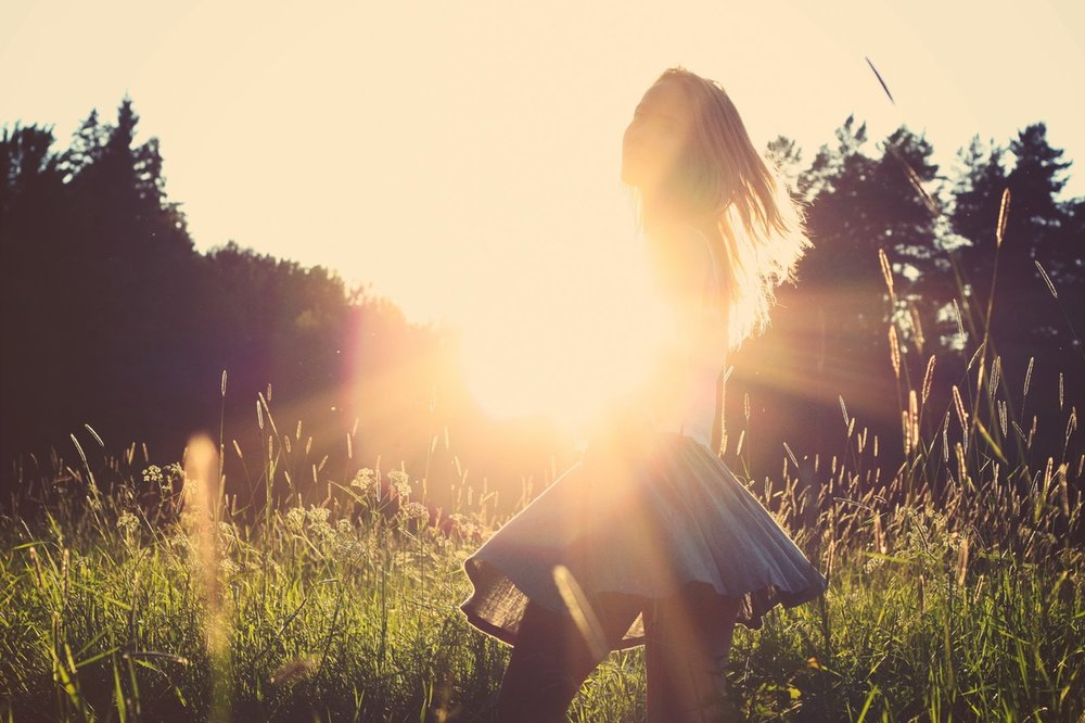 happy girl in sunshine.jpeg