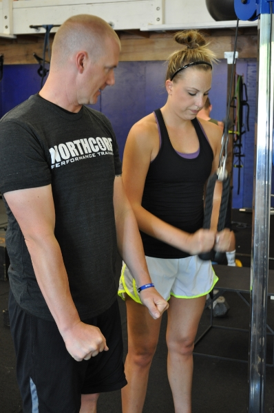 Jeff Millet Personal Trainer instructing tricep rope extension