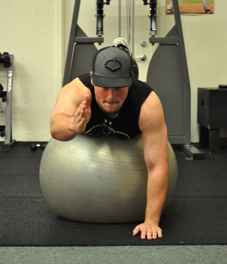Stability ball bird dog exercise for baseball core strength