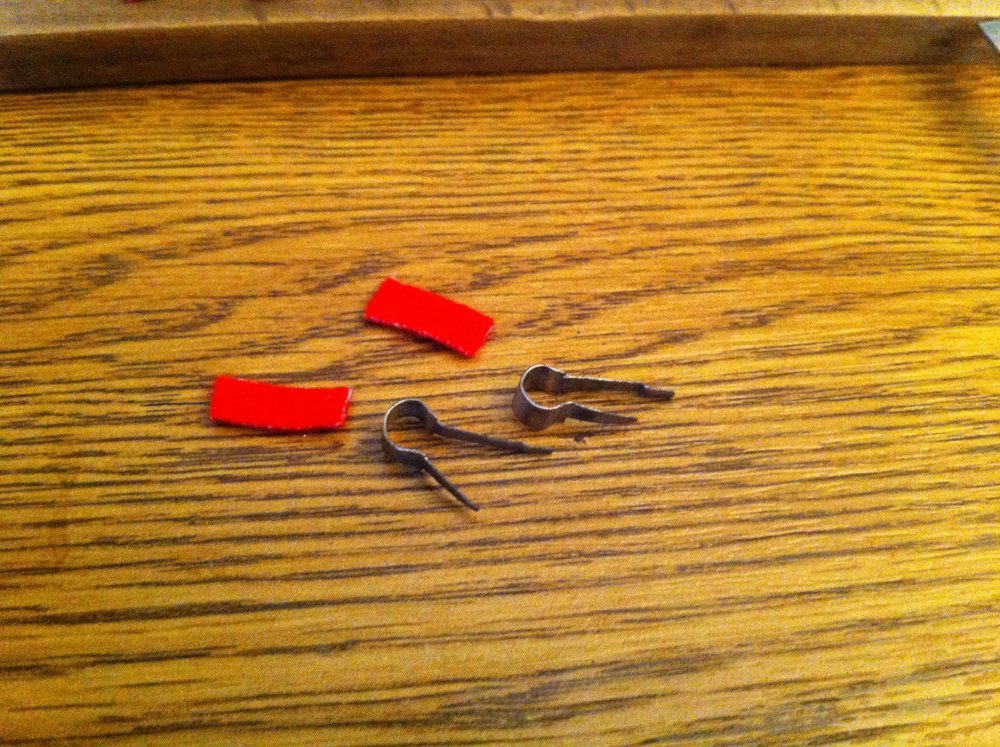 Retaining clips cleaned with bushing cloth ready for instalation