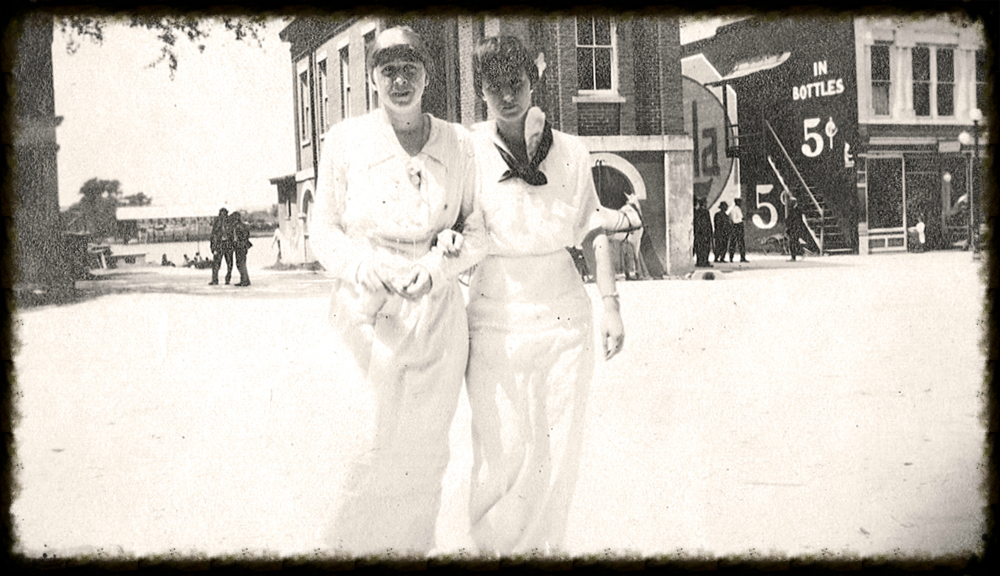 Two women on Front Street, c.1900. Note: 5¢ ad for Cola and Sampit River background. Photo property of Georgetown County Museum. All rights reserved.