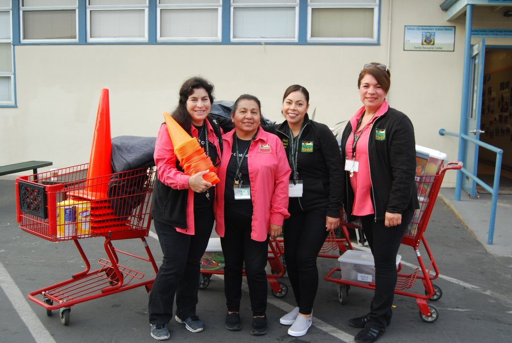 Above Image:   From left to right:  Homeless Liaison Cheryl Camany, Community Coordinator Rosa Salinas and Typist Clerks Liliana Gil-Ramirez and Diana Morales.   Below Image:   From left to right:  Liliana, Cheryl, Rosa and Diana