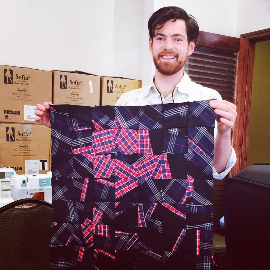 Luke and his finished quilt.