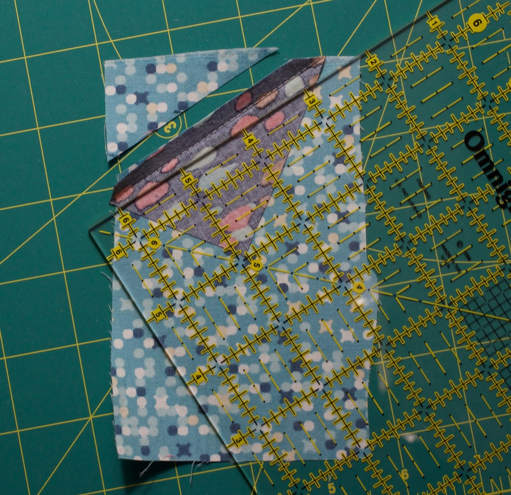 Step 5: trim excess background fabric along seam