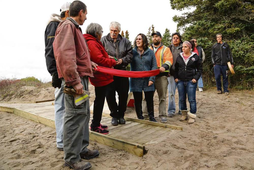 Chief Michano with trail builders and Elders celebrating the Kwewiskaning Trail ribbon cutting ceremony at Biigtigong Nishnaabeg First Nation ©GARY McGUFFIN