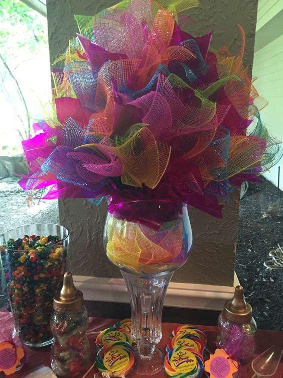This Moroccan inspired centerpiece is oh so cute! Re-create this look with a simple dollar store vase and wreath mesh in your favorite colors!