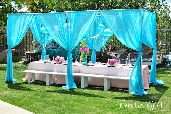 This adorable outdoor set up is much easier to build that it looks! Use PVC pipe to create the structure and wrap curtains your favorite color around the poles!  Our favorite place to purchase affordable chiffon curtains in a variety of colors is Amazon!