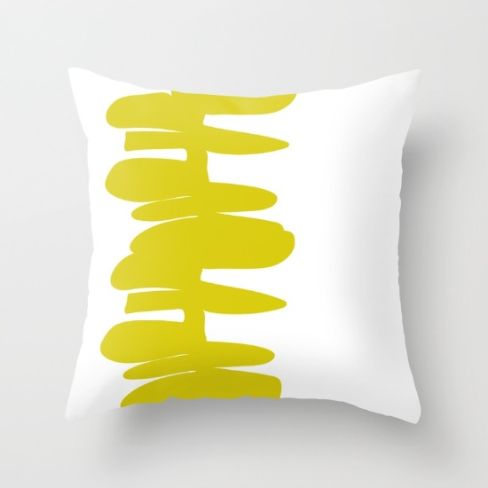 Stacked up pillow in yellow/green