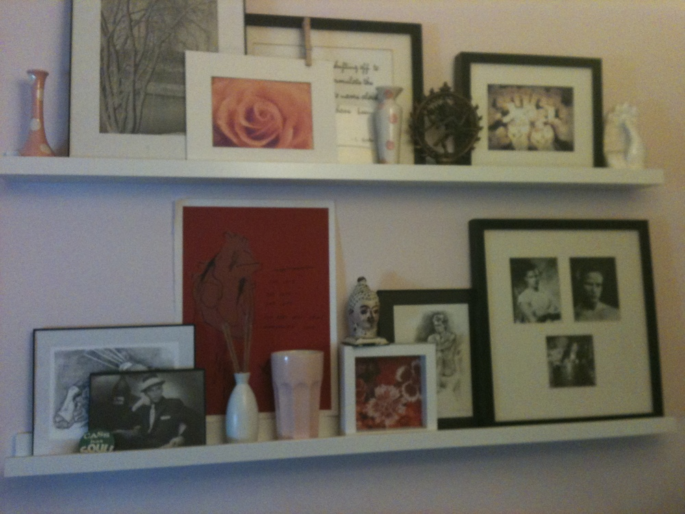An early incarnation of a rotating art display in my last bedroom.