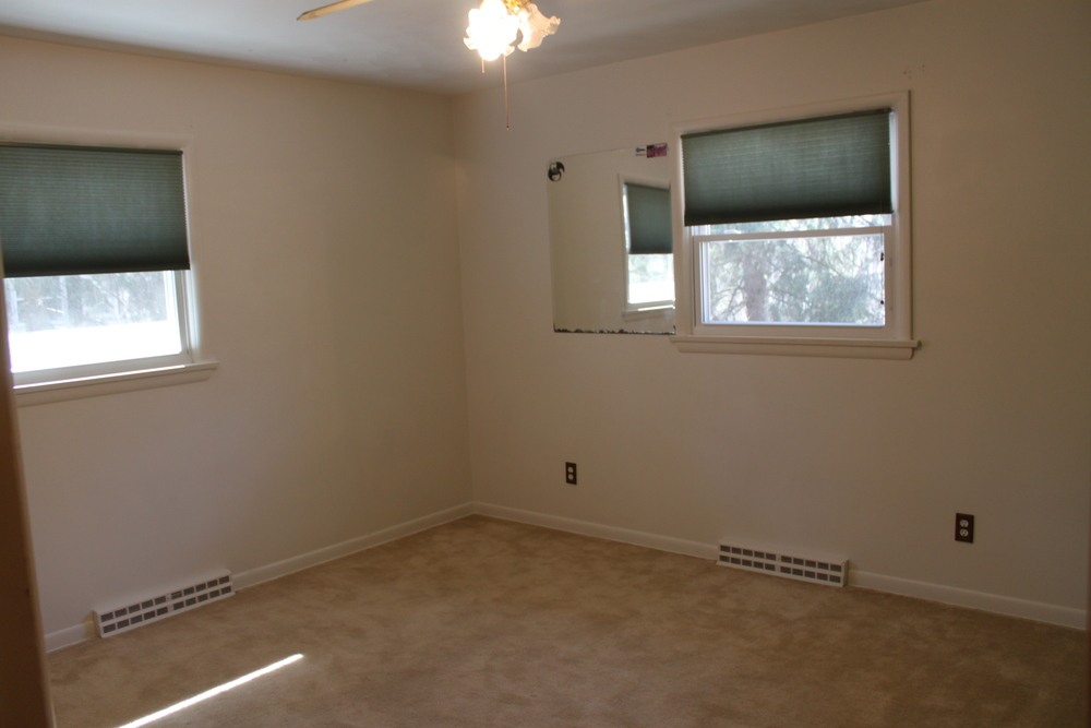 Dingy cream-colored walls, dirty beige carpeting and an oddly placed (and oddly hung) mirror made this space really...BLAH!