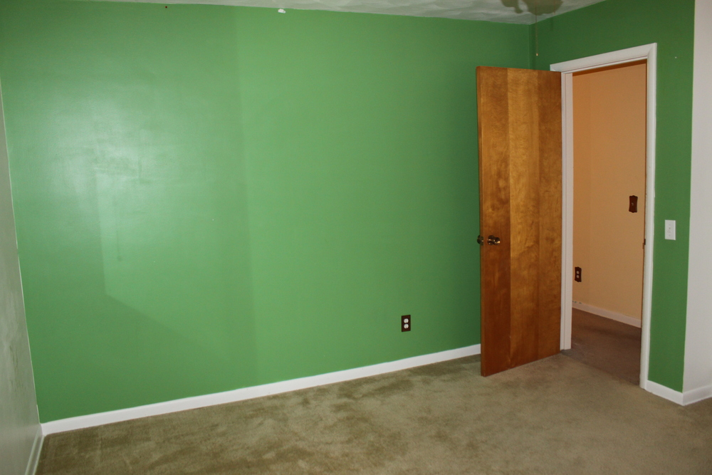 Turning this green wall white was a challenge...but Valspar Optimus paint to the rescue!