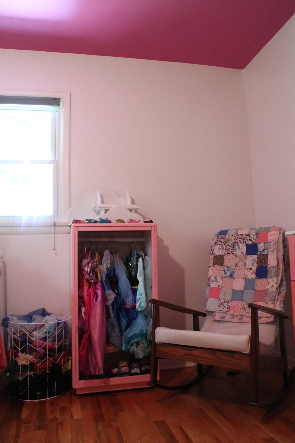 Notice the shelves and other hanging things on top of the closet? Yea...we haven't hung anything up in the room yet.