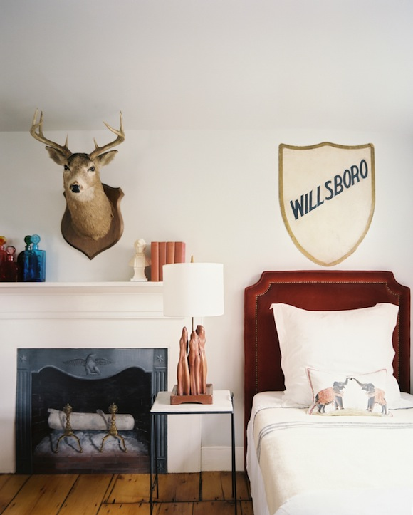This vintage-inspired bedroom with faux fireplace is amazing! (via Mix and Chic)
