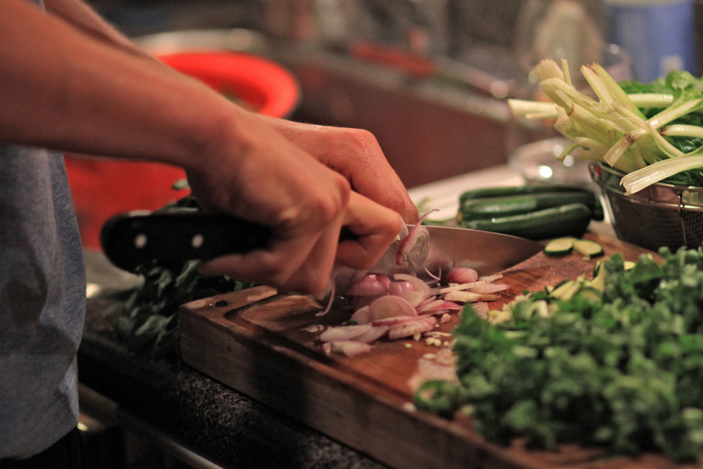 The best dinners are the ones cooked with friends. Here Sander chops up some shallots for our curried lentil dish.