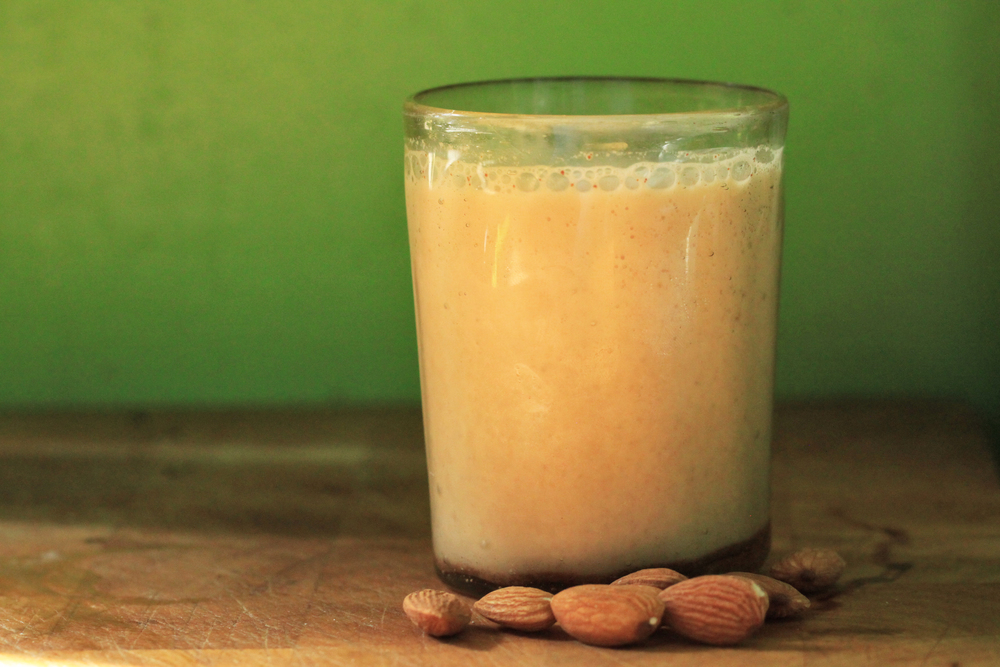 """I normally have a cold almond milk in the morning - but definitely not the store-bought kind because it contains a lot of preservatives and substances like carrageenan to make it feel """"milkier."""" You can get fresh-pressed almond milk (at a premium) or you can make it yourself. Get whole almonds, soak 1 cup of them in water overnight, drain. Add them to a blender (1 cup of almonds = 2 cups of water) and blend. You can also add cinnamon, vanilla, cardamon, nutmeg or anything else non-sugary that you think will be good to taste. Strain the liquid through a nut bag. Enjoy."""