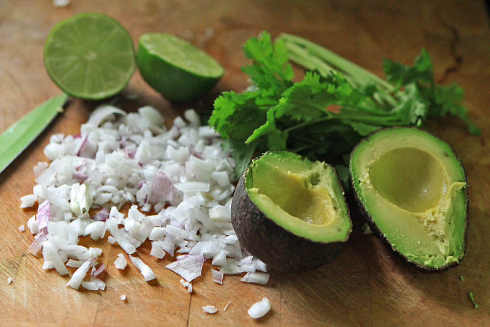 Get your favorite ingredients for your guacamole. I ended up using red onions, cilantro, jalapeno peppers, chile, salt, pepper, a squeeze of lime, and avocados of course!