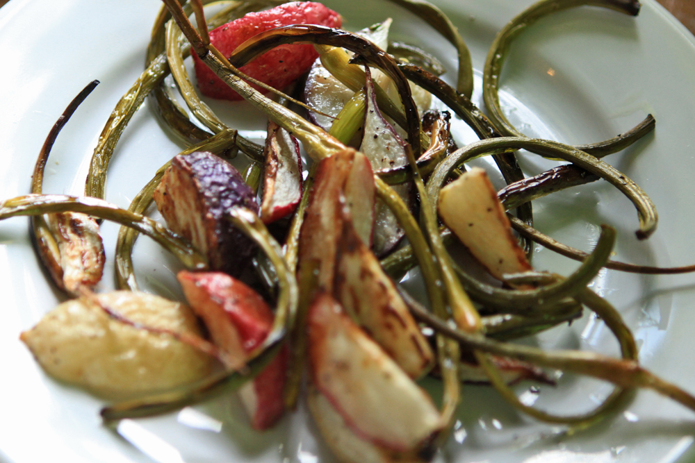 The garlic scapes and radishes both require around 25 minutes in the oven. The scapes got nice and crispy while the radishes still maintained a soft center and crunchy outside, so it was definitely a nice combination.