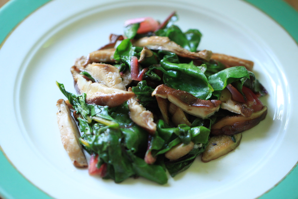 The final product: Sauteed shiitake and Swiss chard. The shiitakes add a nice, subtle, creamy sweetness whereas the chard gives a subtle bitterness. Match made in heaven!