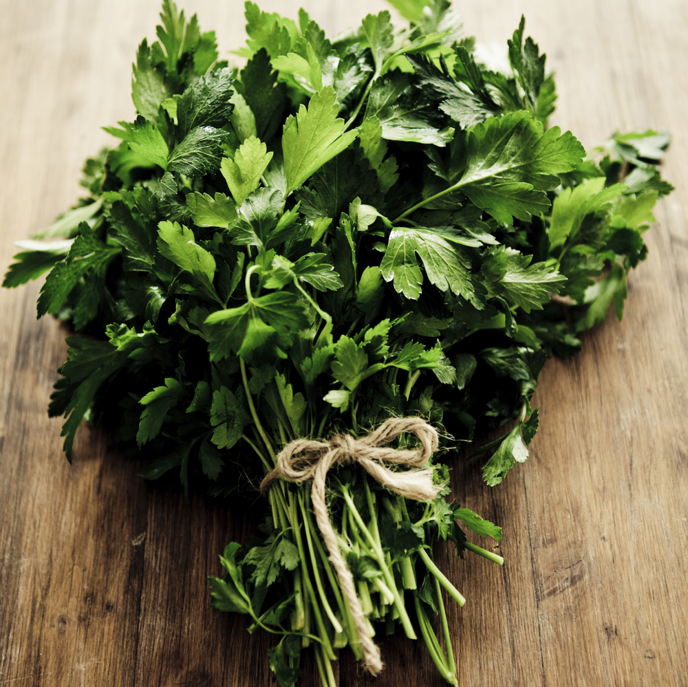 Grab some fresh parsley as the main foundation for your chimichurri sauce.