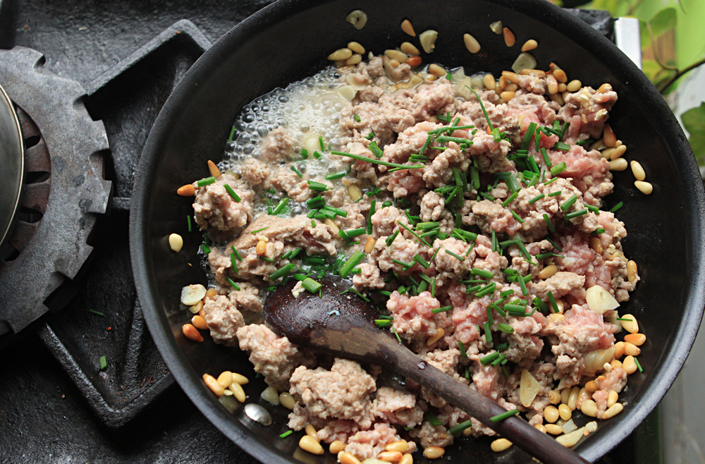 Get fresh ground pork and saute it until it lightly browns. I added garlic and pine nuts to some olive oil before the pork to release some good taste and texture.