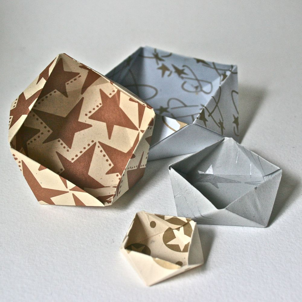 Decorative paper and a few crisp folds take a square into a third dimension