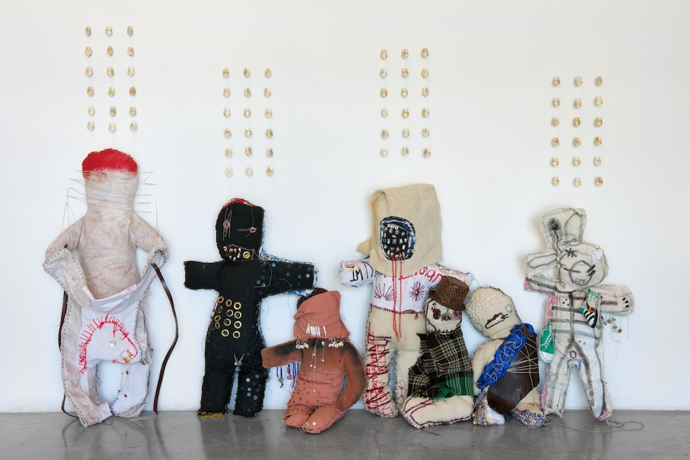 Natalie M. Ball, The Savages, 2009. Mixed Media Dolls & Elk Teeth.
