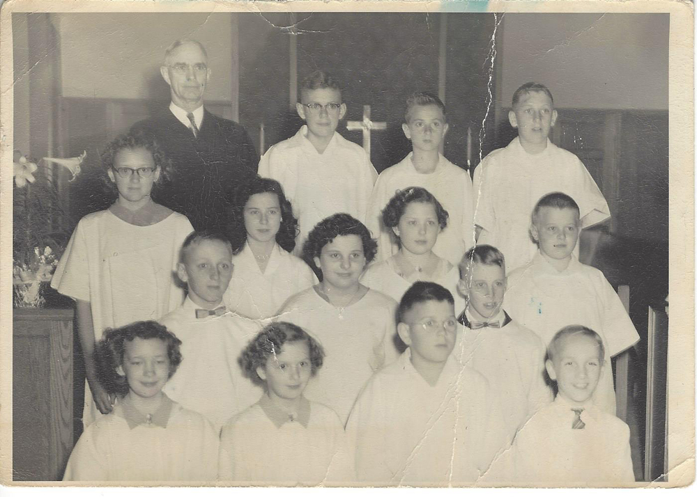 Lonnie is located in the top row and third from the left.