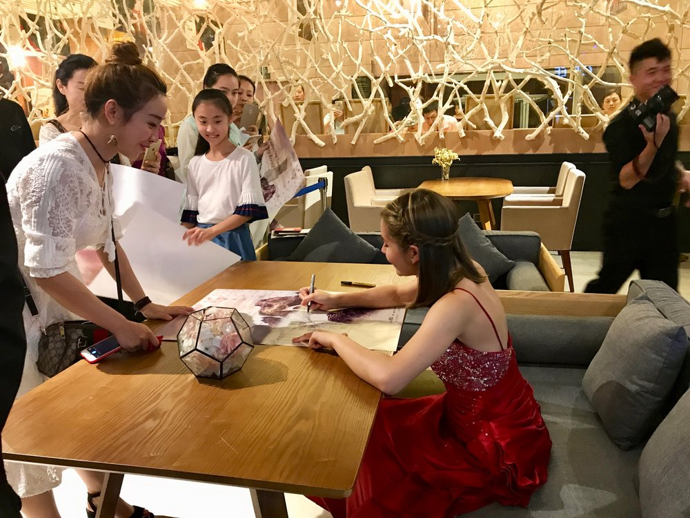 Signing posters after concert in Xi'an, China, in August 2017