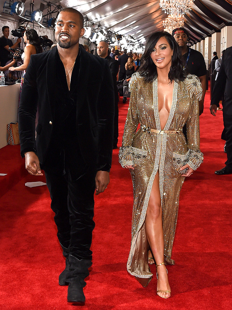 Source: http://cdn.hollywoodtake.com/sites/hollywoodtake.com/files/styles/large/public/2015/02/09/kanye-west-and-kim-kardashian.jpg?itok=yK9CCxo6