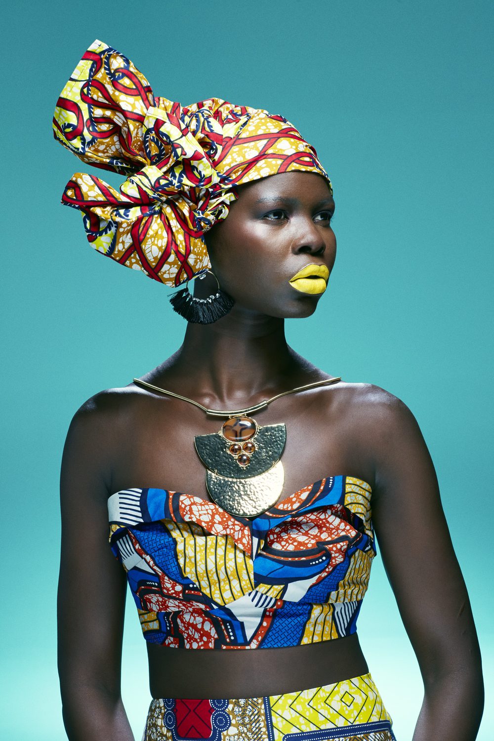 Model achan wears our headwrap toni teamed with a colourful african