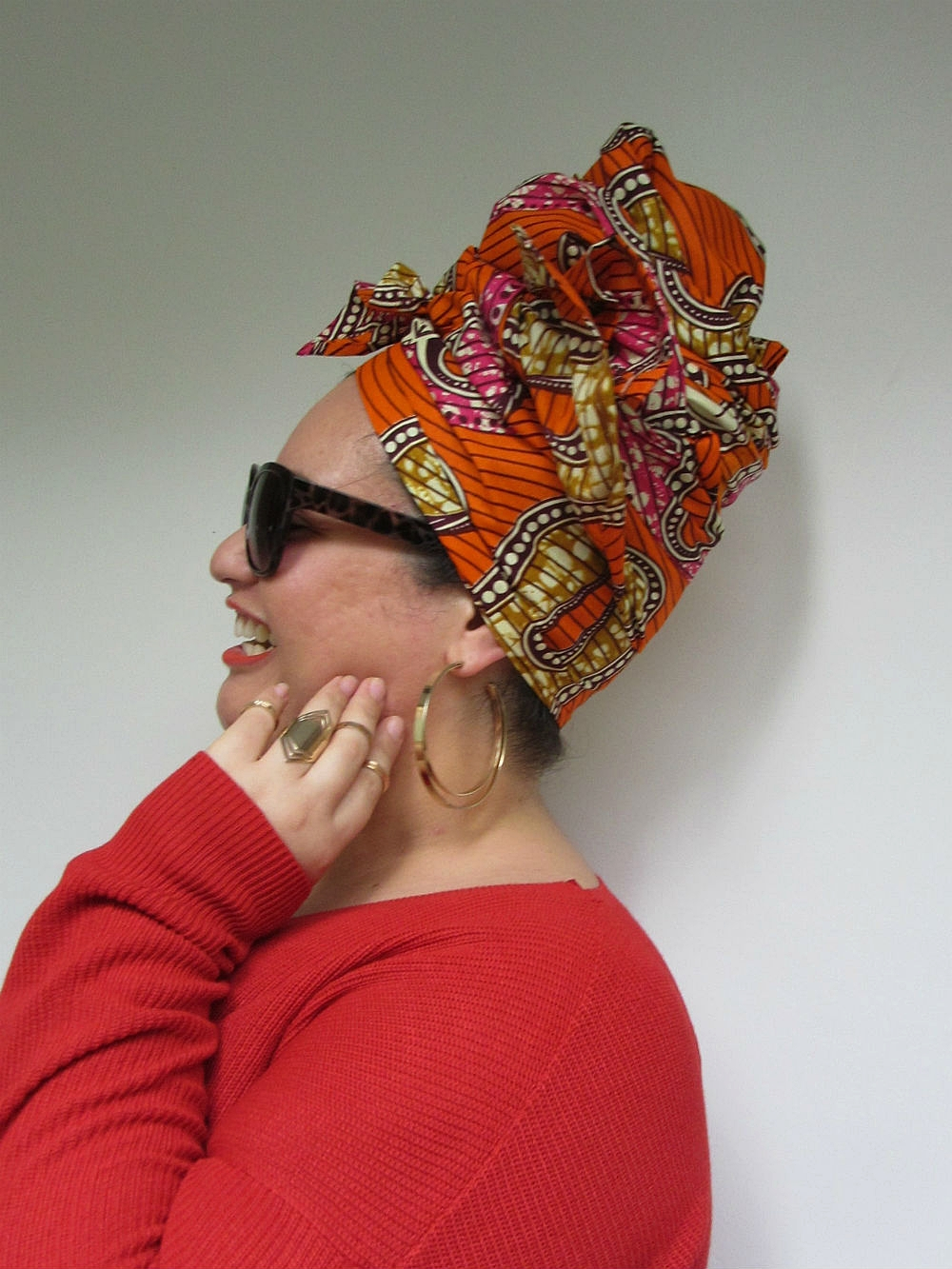 In line with our mood board, MEL G chose a burnt orange loose-fitting jumper which certainly made the colours in headwrap MACY pop even more.