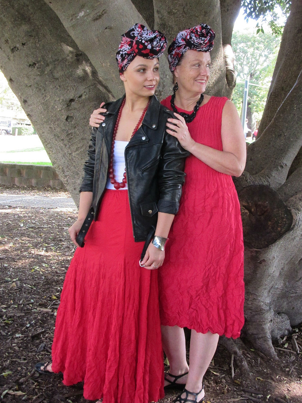 Mama Karen and daughter Zabrina wear batik headwrap GARNET - colour palette red, white and black - look, smart/casual. Headwrap styled in THE TOPKNOT.