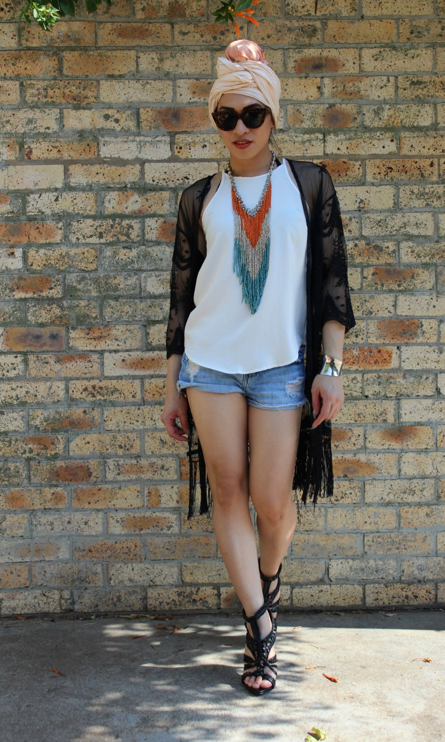 Brand ambassador BIANKA I has teamed tiedye headwrap  PEACHY PEACH  with shorts for a more casual appeal.